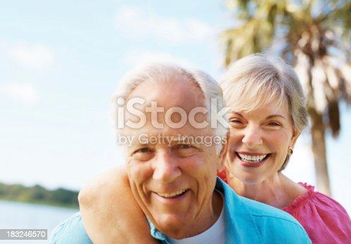 510491454 istock photo Romantic senior couple smiling together 183246570