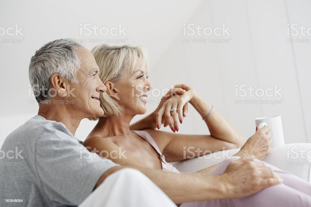 Romantic senior couple with a wife holding coffee cup royalty-free stock photo