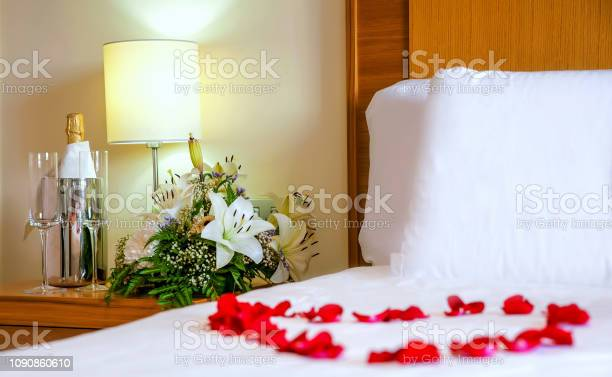 Romantic setup with honeymoon bed with focus on the bouquet and and picture id1090860610?b=1&k=6&m=1090860610&s=612x612&h=tpmnb ducntdklpcvp2li3vnlburnvgsmj63qogdhua=