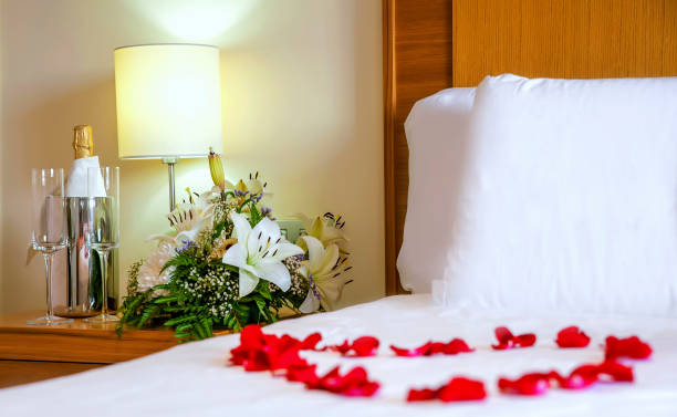 Romantic setup with honeymoon bed with focus on the bouquet and and picture id1090860610?b=1&k=6&m=1090860610&s=612x612&w=0&h=eufvrgclm0r7mqjcb2 wnl lp3eiif ty9b3rf55jn0=
