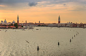 istock Romantic sky of Venice: aerial view of Piazza San Marco or st Mark square, Campanile and Palazzo Ducale or Doge Palace. Italy, Europe. 1057271014