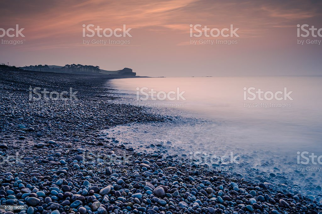 Romantic sunrise on the beach in Budleigh Salterton stock photo