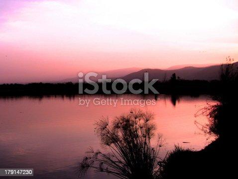 529114076 istock photo Romantic sunset at lake 179147230
