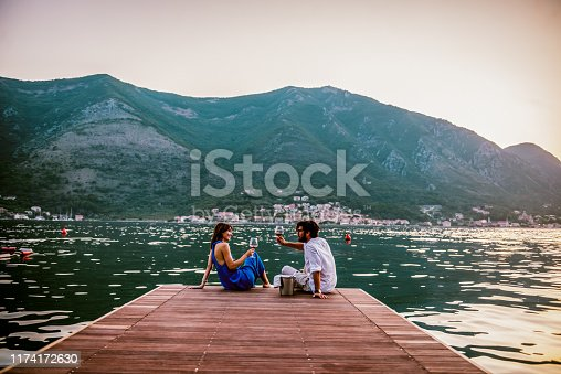 couple in love drink wine during romantic dinner by the sea