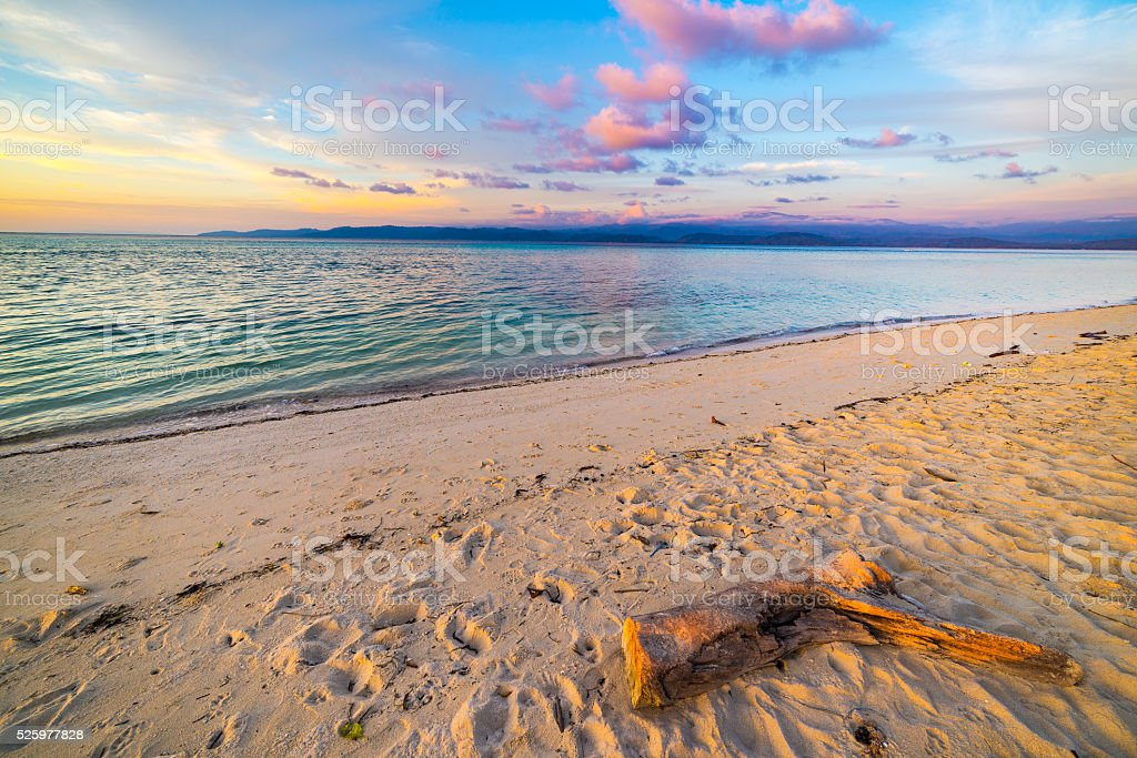 Romantic sunset on desert tropical beach, Indonesia stock photo