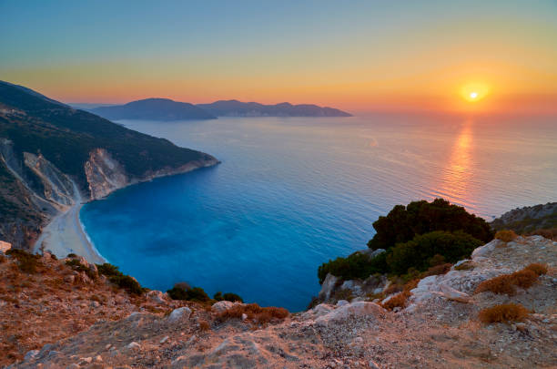 Romantic sunset over Myrtos beach stock photo