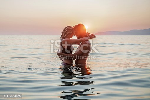 Silhouette of a couple in love in the sea
