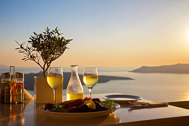 Romantic table for two on the island Santorin Romantic table for two on the island Santorini, Greece. Views of the sea and the volcano volcanic landscape stock pictures, royalty-free photos & images