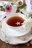 Decorative composition of vintage style: romantic tea drinking with jasmine tea