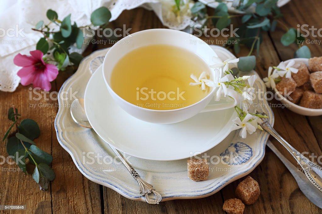 Romantic tea drinking with jasmine tea stock photo