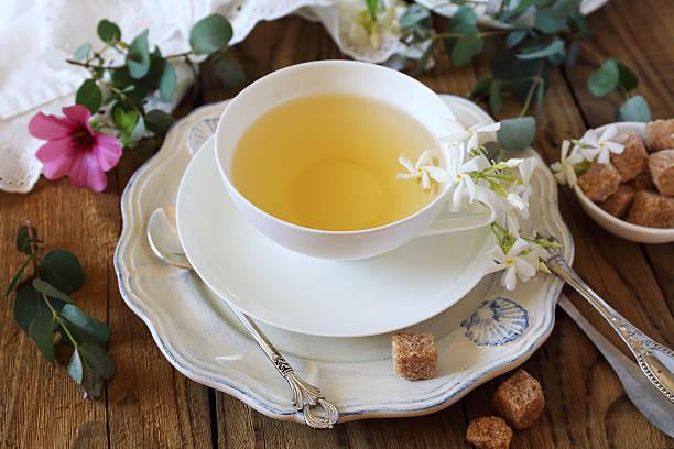 romantic tea drinking with jasmine tea - jasmin party stock-fotos und bilder