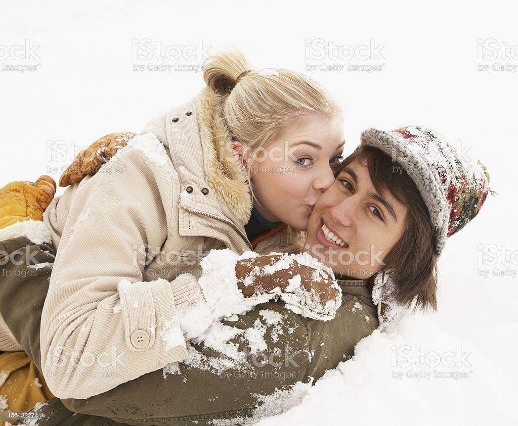 Romantic Teenage Couple Having Fun In Snow royalty-free stock photo