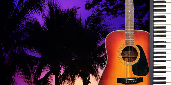 istock Romantic Valentine Love Song by Guitar and piano with twilight dramatic atmosphere on silhouette palm tree Background. 1001932966