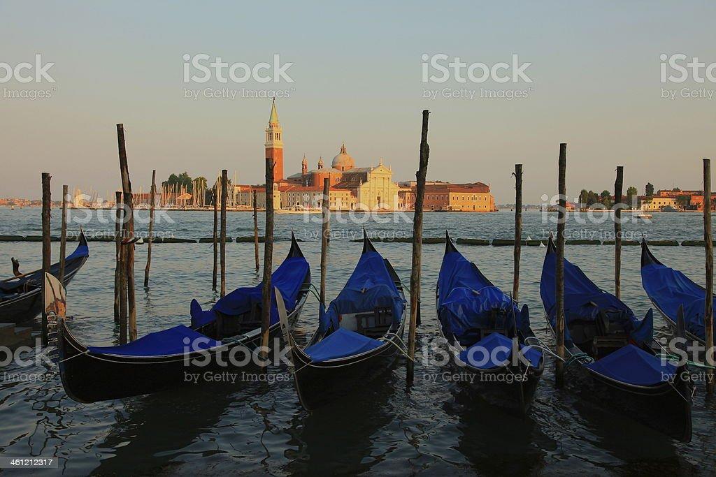 Romantic Venetian Gondolas at sunset - Venice, Italy royalty-free stock photo