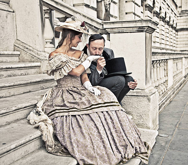 Romantic victorian couple Victorian styled image of a romantic couple embracing on the steps of an old building. kissinghand stock pictures, royalty-free photos & images