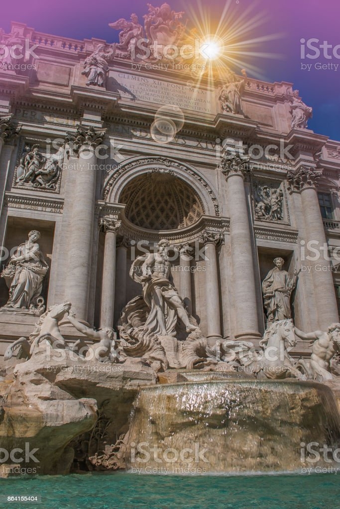 Romantic view of Trevi fountain at sunset in Rome royalty-free stock photo