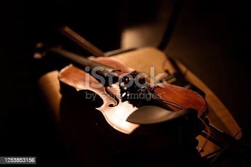 Romantic violin in a shadowy room