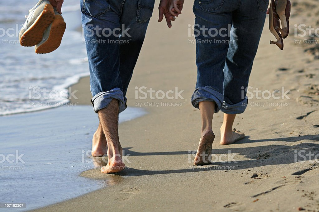 Romantic walk on the beach in Italy stock photo