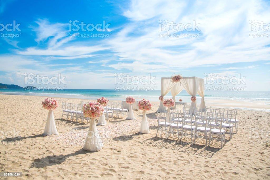 Romantic wedding ceremony on the beach stock photo