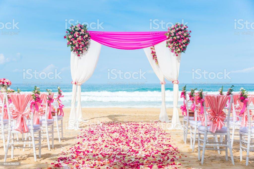 Romantic Wedding setting on the beach. stock photo