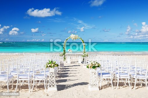 istock Romantic Wedding setting on the beach 905448868