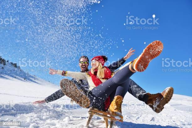 Romantic winter scene happy young couple having fun on fresh show on picture id903984854?b=1&k=6&m=903984854&s=612x612&h=8kafuld1gx8hu3ubjzrt8stwfd0usztbobg4a3hf3zm=