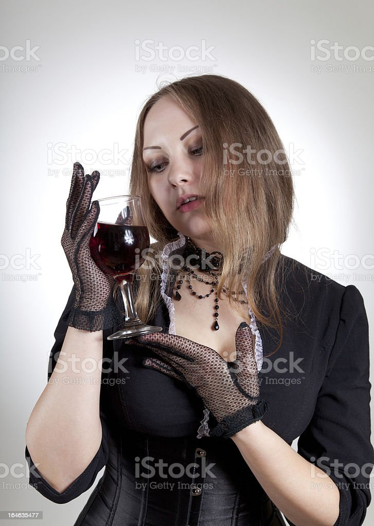 Romantic woman with glass of wine royalty-free stock photo