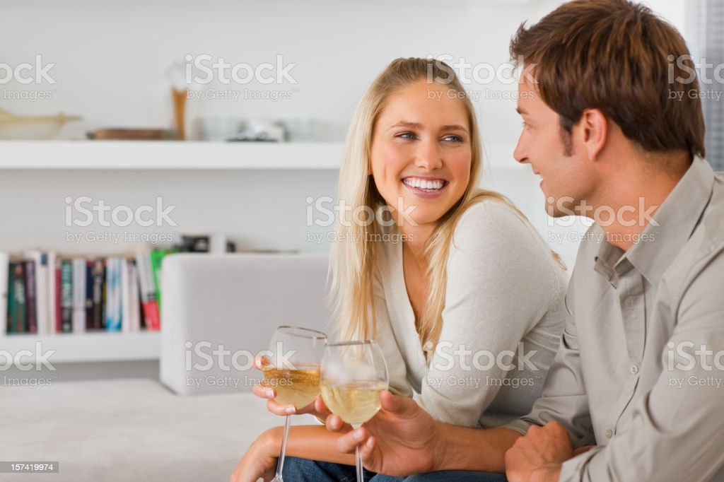 Romantic young couple holding wineglass royalty-free stock photo
