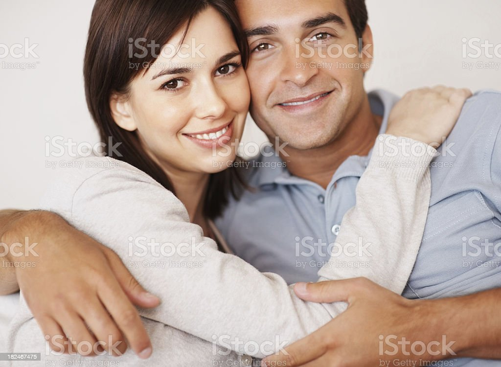 Romantic young couple hugging eachother at home royalty-free stock photo