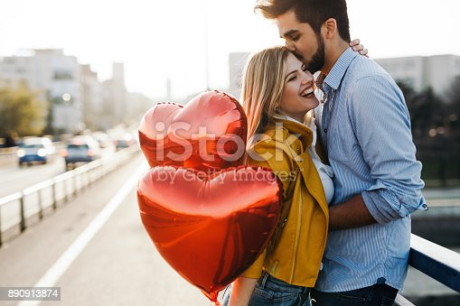 Romantic young couple in love, hugging on the street on valentine day