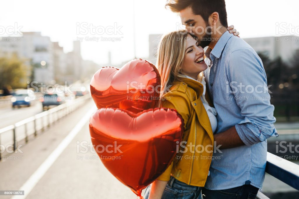Romantic young couple in love, hugging on the street stock photo