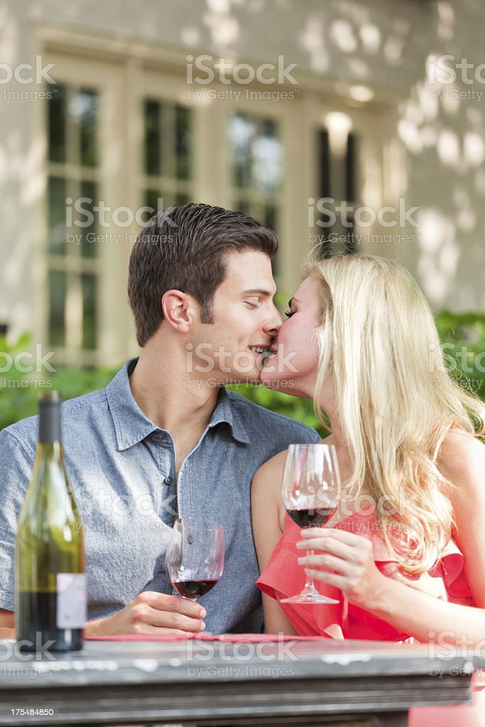 Romantic Young Couple Kissing in Outdoor Cafe royalty-free stock photo