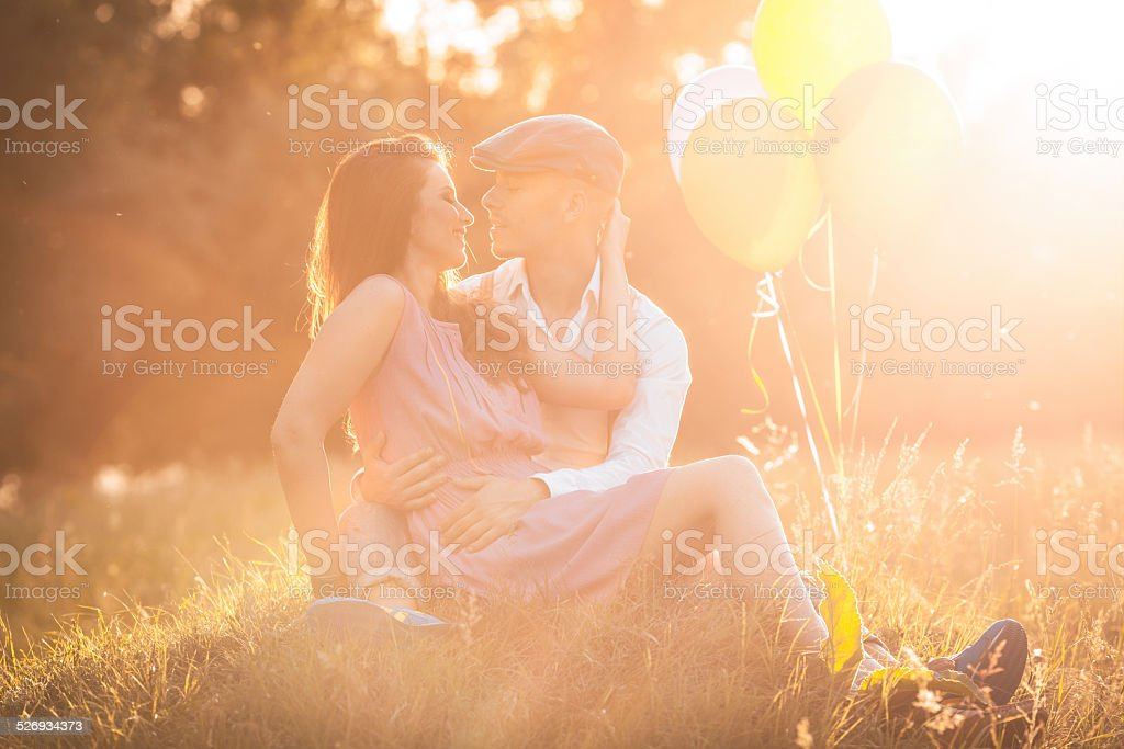 Romantic young couple on a sunny day outdoors stock photo