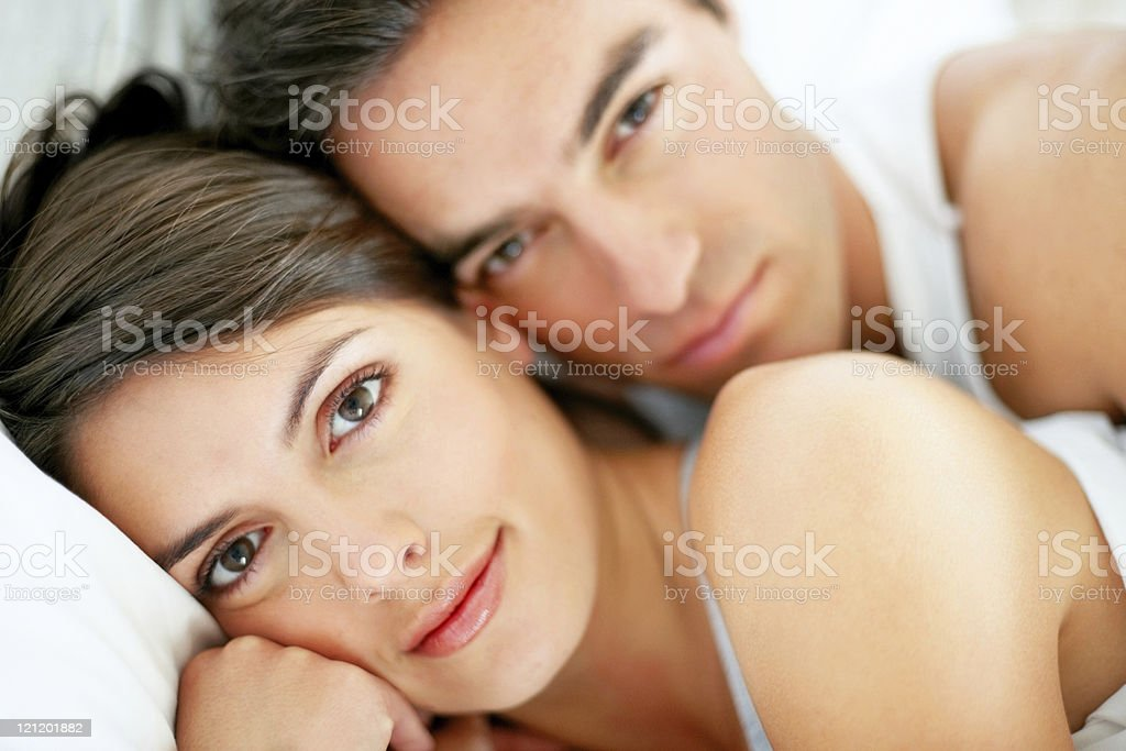 Romantic young couple relaxing in bed royalty-free stock photo