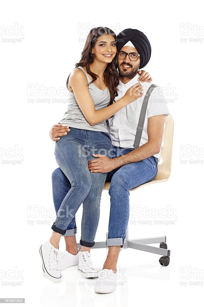 Romantic young couple sitting on a chair royalty-free stock photo