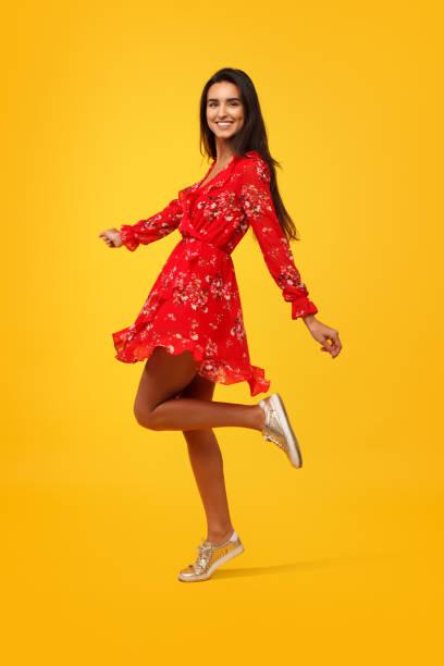 romantic young girl in dress - женская мода стоковые фото и изображения