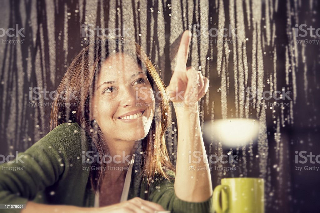 romantic young girl looks at  rain through the window royalty-free stock photo