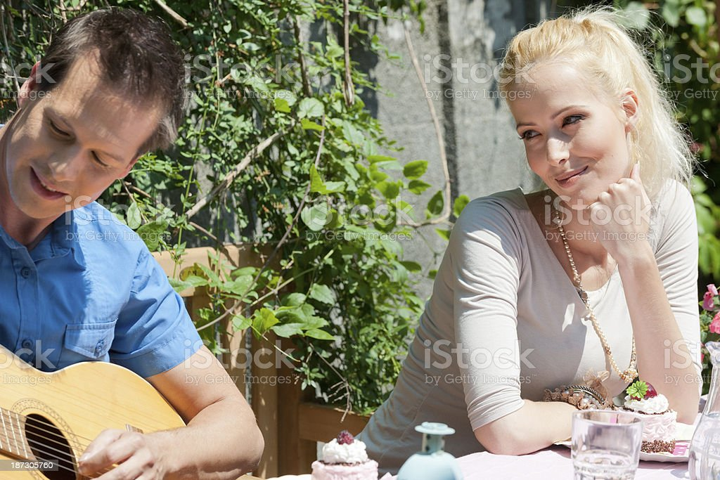 romantic young man playing acoustic guitar royalty-free stock photo