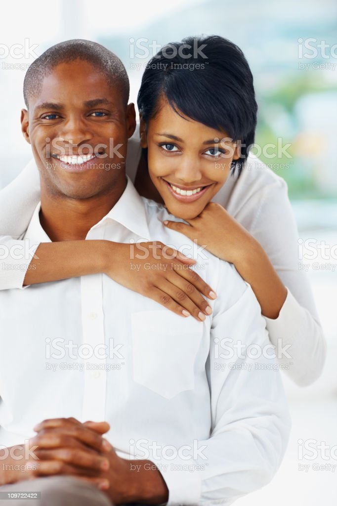 Romantic young woman embracing a man from back royalty-free stock photo