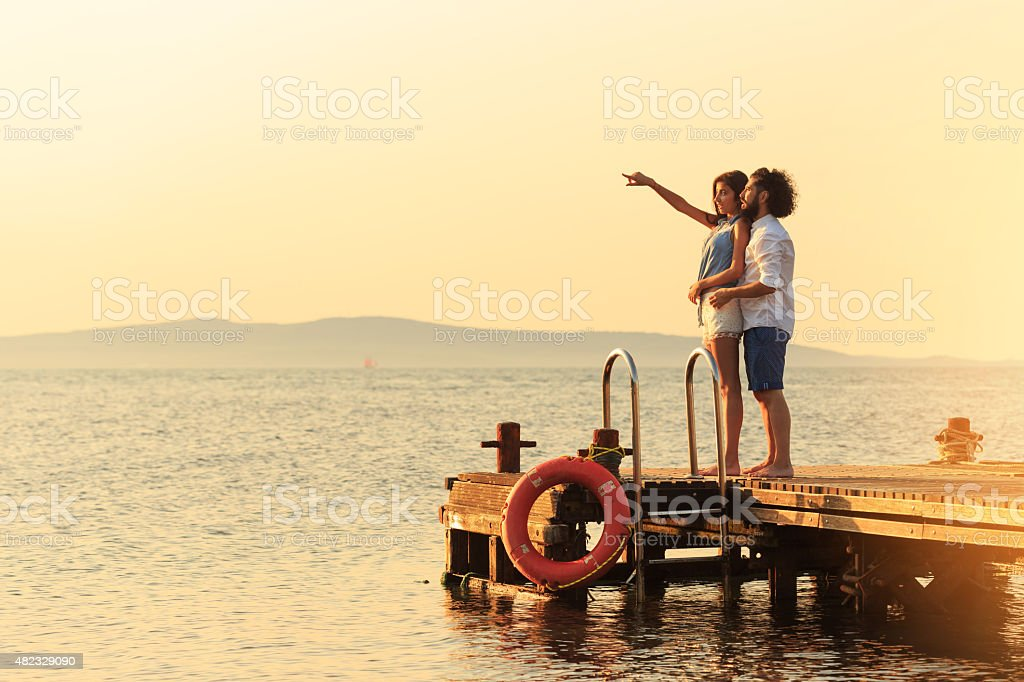 Romantics on the dock stock photo