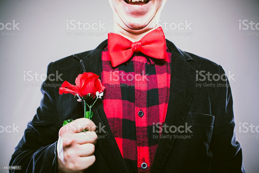 Romatic Nerd Lover Boy with Red Rose and Bow Tie royalty-free stock photo