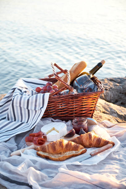 Romatic picnic on the beach stock photo