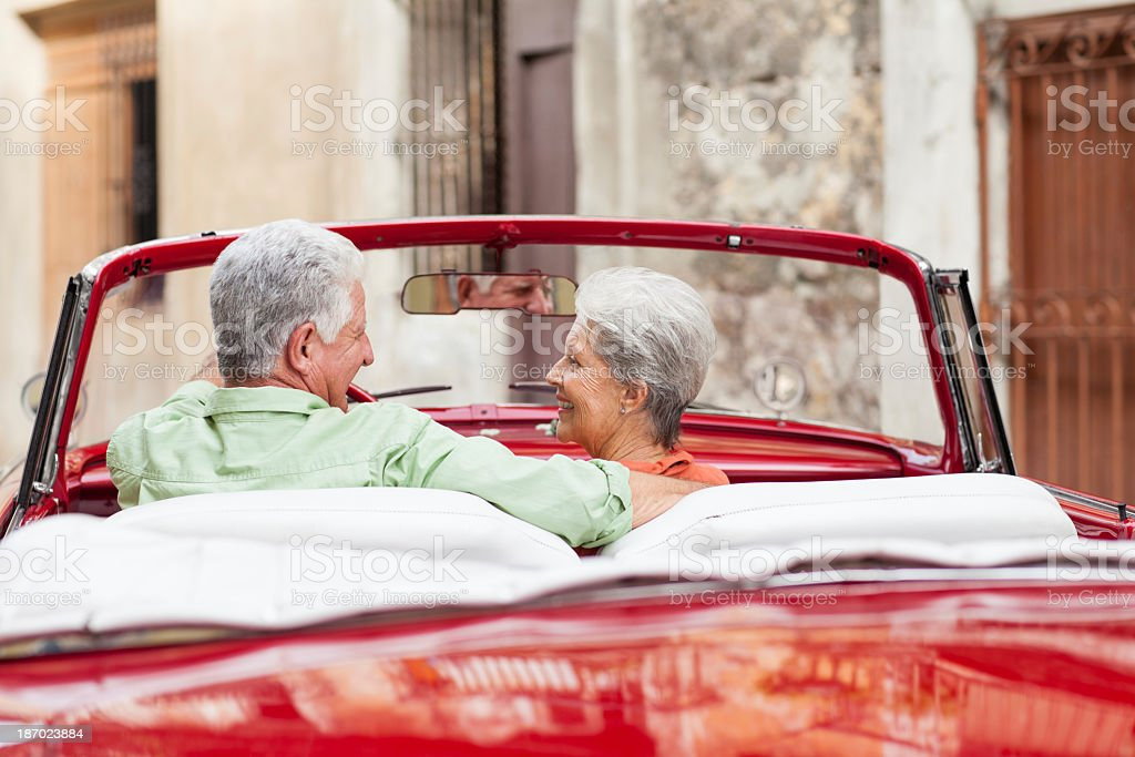 Romatic senior couple driving in Cuba royalty-free stock photo