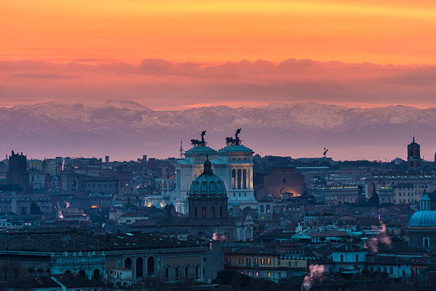 Rome at sunrise with mountains in background Rome at sunrise in a cloudy day showing Vittorio Emanuele II monument with mountains in the background ancient rome stock pictures, royalty-free photos & images