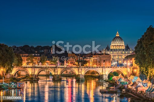 Rome city skyline with Tiber and St Peters Basilica Vatican Italy at night
