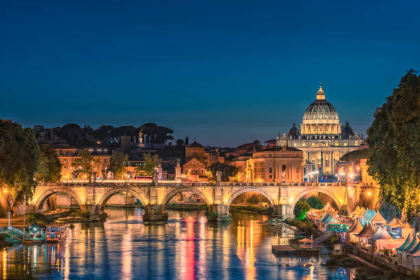 Rome city at night with Tiber river and St. Peter's Basilica, Italy Rome city skyline with Tiber and St Peters Basilica Vatican Italy at night lazio stock pictures, royalty-free photos & images