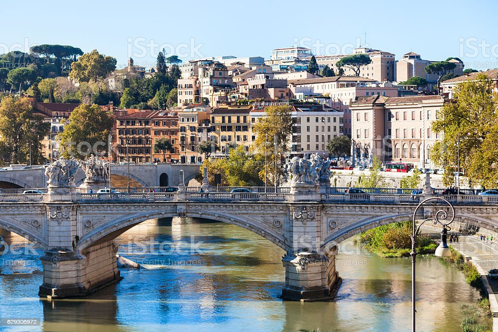 Rome city skyline with Tiber River and bridge stock photo
