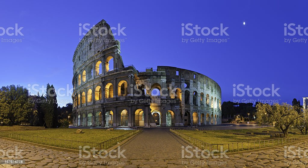Rome Coliseum ancient Roman amphitheatre illuminated piazza panorama Italy stock photo
