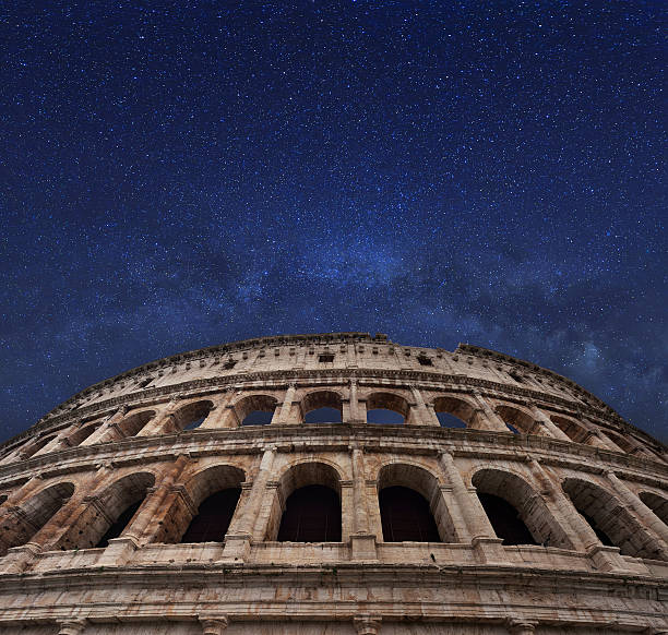 Rome coliseum and milky way in the midnight sky Famous Rome coliseum and milky way in the midnight sky. Italy. ancient rome stock pictures, royalty-free photos & images
