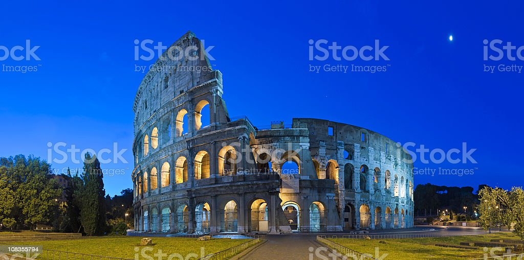 Rome Coliseum by moonlight ancient Roman amphitheater night panorama Italy stock photo